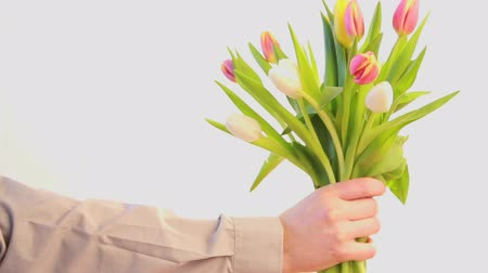 springtime : Man offering a bouquet of red and yellow tulips for mothers day Stock Footage