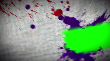 boyalar : Paint spatter revealing chroma key spaces on moving background