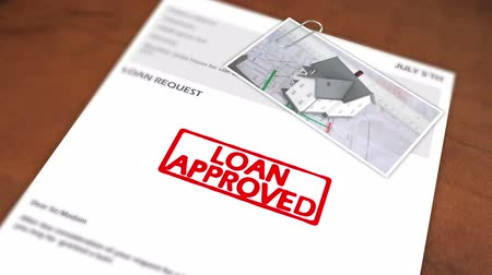 ипотека : Animated stamp spelling out loan approved in red on loan application Стоковые видеозаписи