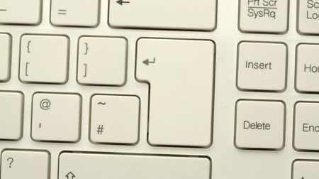 presleme : Hand pressing enter key twice on white keyboard Stok Video