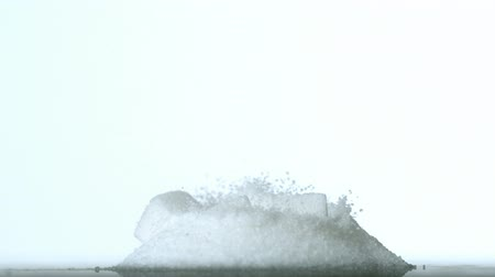 szőlőcukor : Sugar cubes falling into pile of sugar in slow motion Stock mozgókép