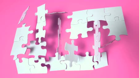 головоломка : Jigsaw puzzle falling on pink surface in slow motion