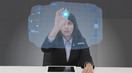 футуристический : Businesswoman selecting futuristic interface with her finger