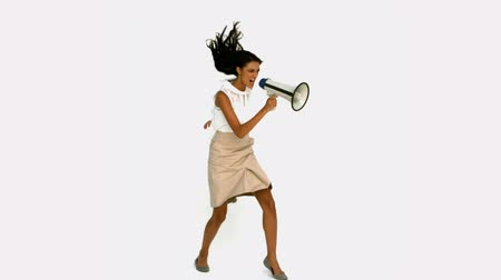 řvát : Angry businesswoman shouting on megaphone in slow motion