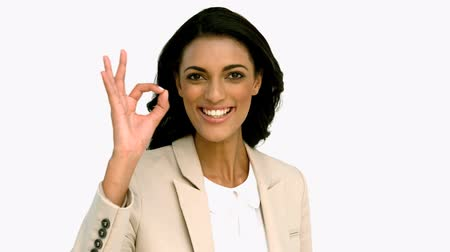 taça : Businesswoman giving ok sign in slow motion
