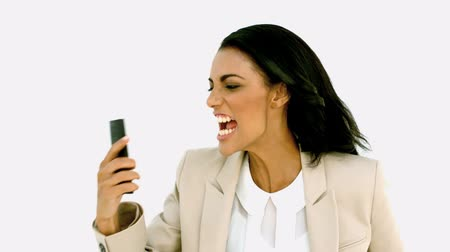 держит : Businesswoman screaming down her mobile phone in slow motion