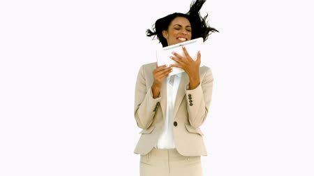 bajnok : Businesswoman jumping and holding tablet on white background in slow motion Stock mozgókép