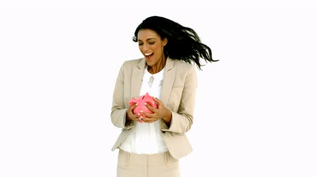 сотрясение : Businesswoman jumping and holding piggy bank in slow motion