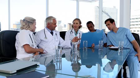 сотрудники : Medical team during a meeting in office