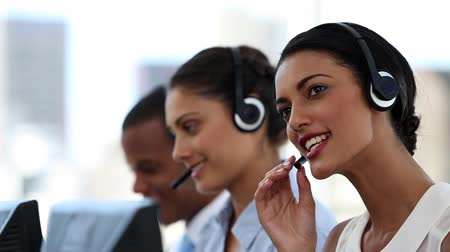 хайтек : Call centre agents working in their bright office
