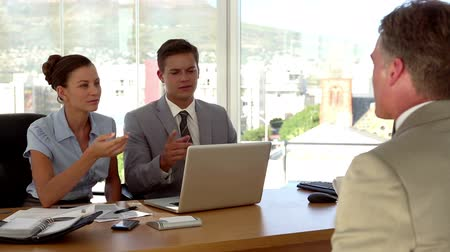 suit and tie : Applicant having a job interview in front of business people using a laptop in their office Stock Footage