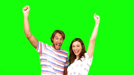 кричать : Two friends raising their arms on a green screen in slow motion Стоковые видеозаписи