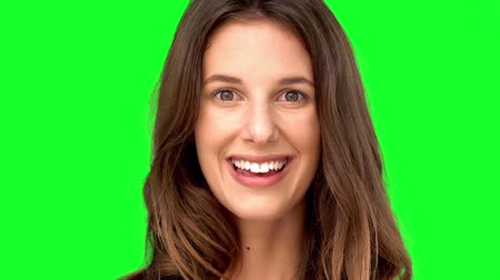 vigyorgó : Surprised woman smiling on green screen in slow motion Stock mozgókép