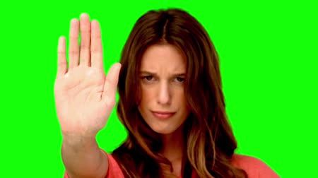 filmagens : Woman showing the stop sign with her hand in slow motion
