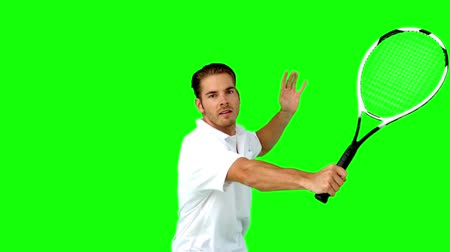 tennis game : Man playing tennis in slow motion on green screen