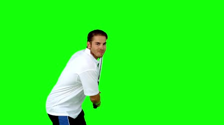 tennis game : Attractive man playing tennis in slow motion on green screen