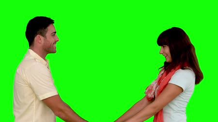 romantic couple : Young couple cuddling on green screen in slow motion on green screen