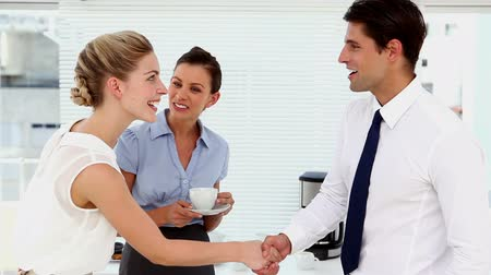 сотрудники : Business people meeting and shaking hands at break time