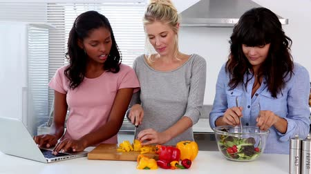 food preparation : Friends following an online recipe then preparing a salad