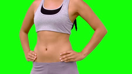 abs : Athletic woman turning to camera against green screen  in slow motion  Stock Footage