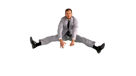 jump : Businessman jumping and doing the splits in slow motion on white background Stock Footage