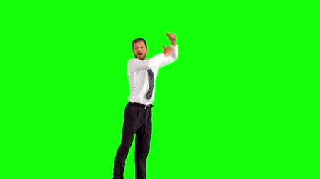 жест : Businessman jumping and giving thumbs up on green screen in slow motion