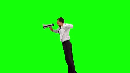 мегафон : Businessman holding megaphone jumping up on green screen in slow motion Стоковые видеозаписи