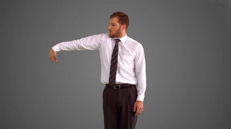 business man : Businessman body popping on grey background in slow motion