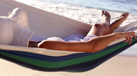 гамак : Woman relaxing in a hammock on a sunny beach