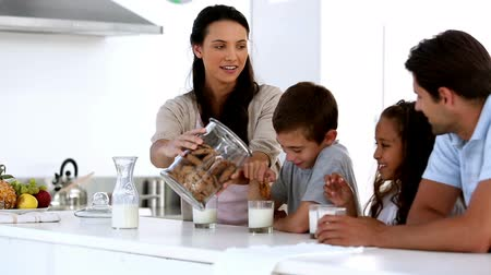 counter : Mother giving cookies to her family at home in kitchen Stock Footage
