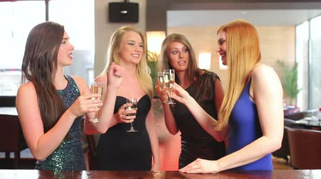 chatting : Well dressed friends having a toast with champagne in a classy bar Stock Footage