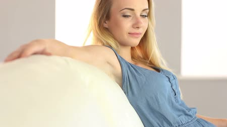 serene : Beautiful blonde teen relaxing on the couch in her sitting room at home