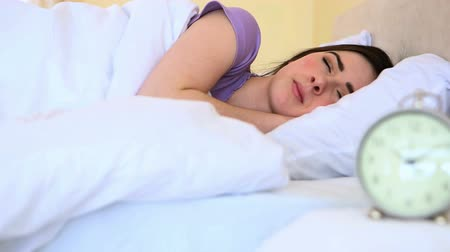 napping : Attractive woman sleeping in bed in the bedroom