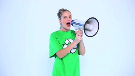 megafon : Attractive environmental activist screaming in a megaphone on white background