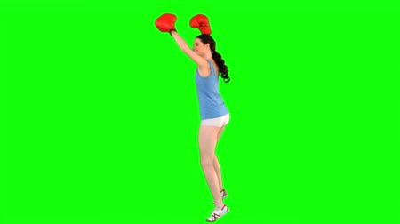 vysoká klíč : Energetic model with boxing gloves turning round on green background Dostupné videozáznamy