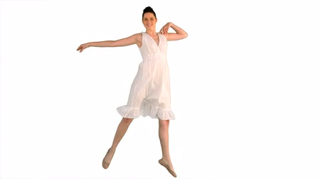 brown dress : Beautiful model in white dress jumping on white background Stock Footage