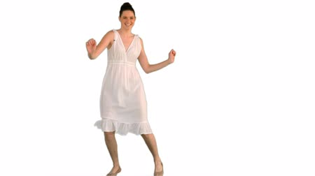 brown dress : Beautiful young model in white dress dancing on white background