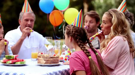 девушка : Family celebrating the birthday of a girl in the garden