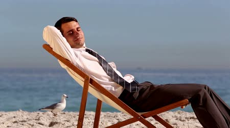 napping : Businessman sleeping on the beach