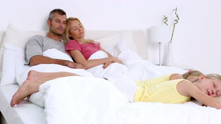 napping : Parents sleeping with their daughters on bed