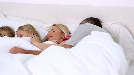 napping : Parents and daughters sleeping on a bed