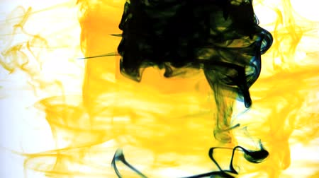 yellow ink : Yellow ink swirling into water whirlpool in slow motion Stock Footage