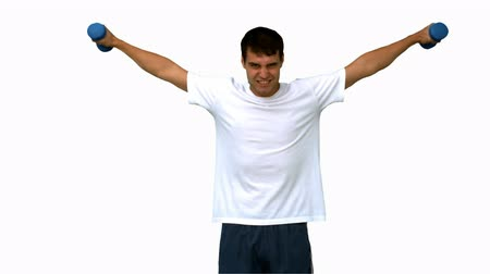 lento : Attractive man lifting dumbbells on white screen in slow motion Vídeos