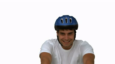 helmets : Man on his bicycle on white screen in slow motion Stock Footage
