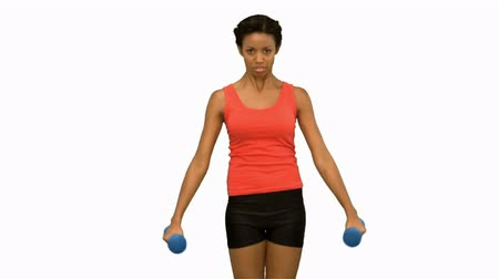 musculação : Pretty woman lifting dumbbells on white screen