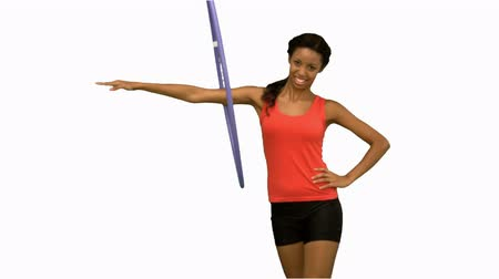abroncs : Woman working out with a hula hoop on white screen in slow motion Stock mozgókép
