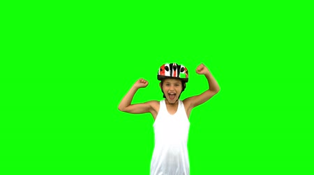 torcendo : Cute girl wearing a bike helmet and raising arms on green screen in slow motion Stock Footage