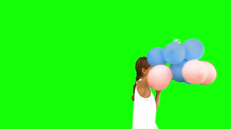 verde : Little girl playing with balloons on green screen in slow motion Vídeos