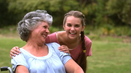 rokkant : Smiling grandmother with her grand-daughter in slow motion