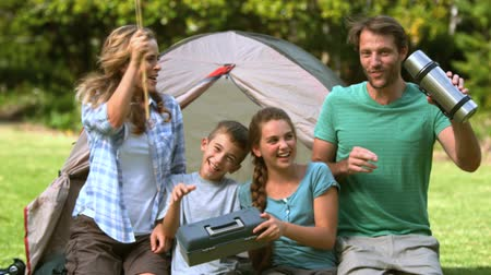 ostoba : Happy family dancing in front of the tent in slow motion  Stock mozgókép